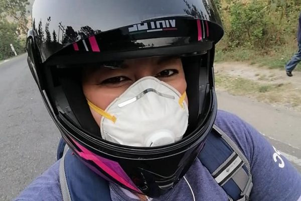 Surama, a nurse and health promoter, travels by motorcycle.